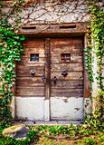 Old wooden textured door and weathered wall