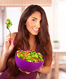 Sportive girl eating vegetarian salad