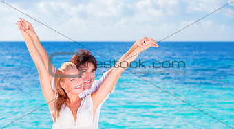 Happy couple having fun on the beach