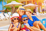 Mother with kids on beach resort