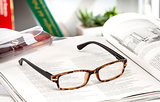 reading glasses endorsed on a magazine at home