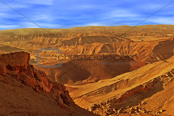 Mountains in Arava desert under beautiful sky in Israel.