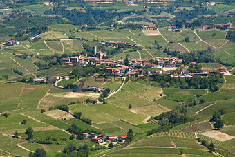 Green hills and vineyards of Langhe in early spring in Piedmont, Northern Italy (view from above).
