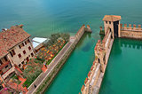 Fragment of surrounding wall of medieval Scaliger castle situated on Lake Garda in Italy (view from above).