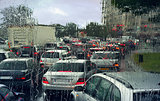 View through wet windshield on cars in a traffic jam on rainy day in Paris, France.