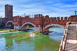 Famous red brick Castelvecchio bridge across Adige river in Verona, Italy.
