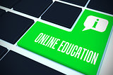 Online education against green key on black keyboard