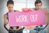 Woman holding pink card saying work out