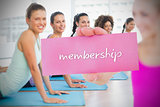 Fit blonde holding card saying membership