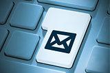 Composite image of envelope on enter key