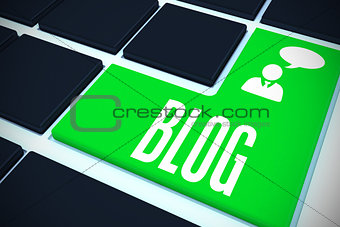 Blog on black keyboard with green key