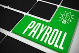 Payroll on black keyboard with green key