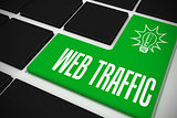 Web traffic on black keyboard with green key
