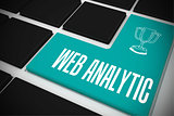 Web analytic on black keyboard with blue key
