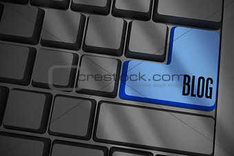Blog on black keyboard with blue key