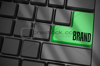 Brand on black keyboard with green key