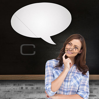 Composite image of thoughtful woman with speech bubble placing her finger on her chin