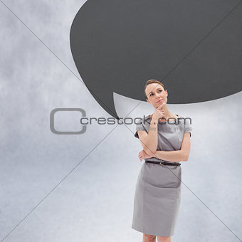 Thoughtful woman posing in dress with speech bubble