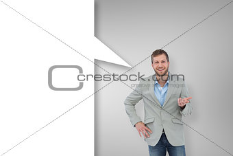 Composite image of stylish man smiling and gesturing with speech bubble