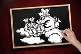 Composite image of hand drawing money bags with chalk