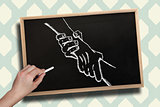 Composite image of hand drawing handshake with chalk