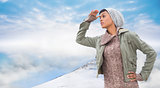 Composite image of concentrated young model in winter clothes watching around her