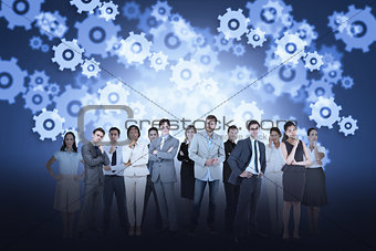 Business team against cogs and wheels background