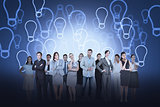 Business team against light bulb background