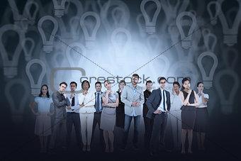 Business team against light bulb background