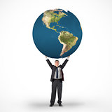 Composite image of mature businessman holding globe