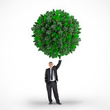 Composite image of businessman holding green sphere