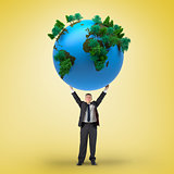 Composite image of businessman holding earth