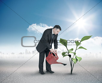 Composite image of mature businessman using watering can