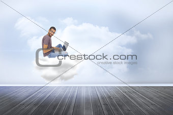 Composite image of man wearing glasses sitting on cloud  using laptop and looking at camera