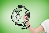 Composite image of businesswoman drawing globe