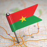 Burkina Faso Small Flag on a Map Background.
