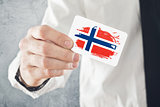 Norweigan Businessman holding business card with Norway Flag