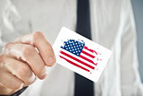 American Businessman holding business card with USA Flag