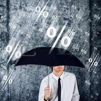 Businessman with umbrella protecting himself from percentage rai