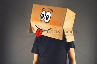 Happy smiling man with cardboard box on his head