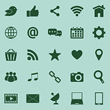 Social media color icons on green background