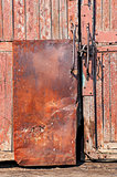 old wooden door with iron -coated