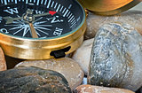 Navigation compass on stone pebbles
