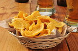 Basket of corn chips and beer