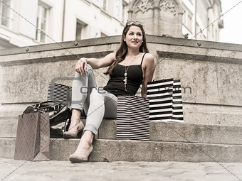 Young woman in the city with shopping bags