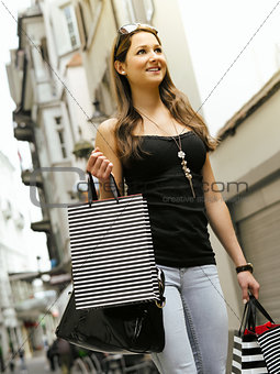 Young woman in the city shopping