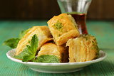 traditional Turkish arabic dessert - baklava with honey and pistachios