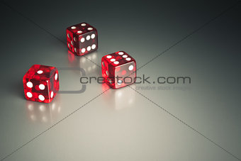 three dice in the corner on a silver table