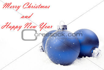 blue christmas decoration on snow