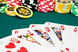 poker, royal flush and unfocused gambling chips
